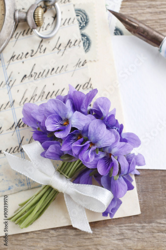 Fotografie, Obraz  Bouquet of violet flowers (viola odorata) and vintage letters