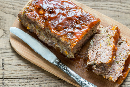 Fotografie, Obraz  Meat loaf with barbecue sauce on the wooden board