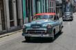 Grey vintage car in the streets of Havana, Cuba
