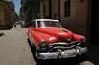 Red classic car in Cuba