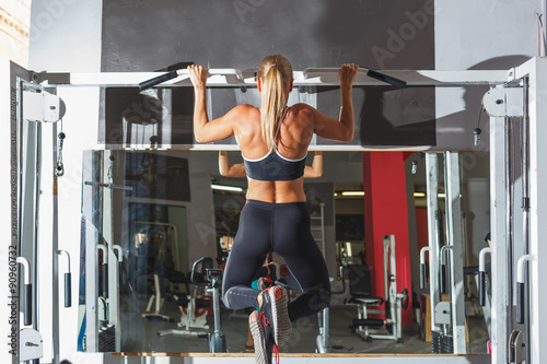 woman doing pull-ups Canvas Print