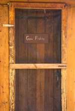 Gone Fishing Sign On Wooden Ca...