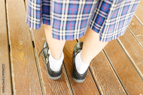 76d602d1076c Asian Thai school girl student is wearing a black leather shoes ...