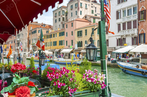 Foto  Sidewalk Cafe in Grand Canal of Venice, Italy