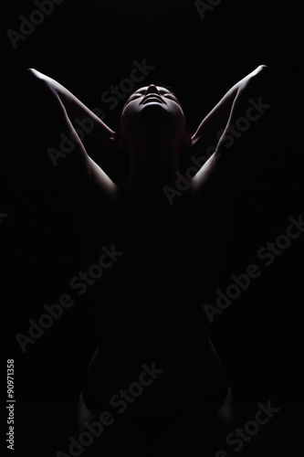 dark female silhouette,hands and face.art photo of nude body girl