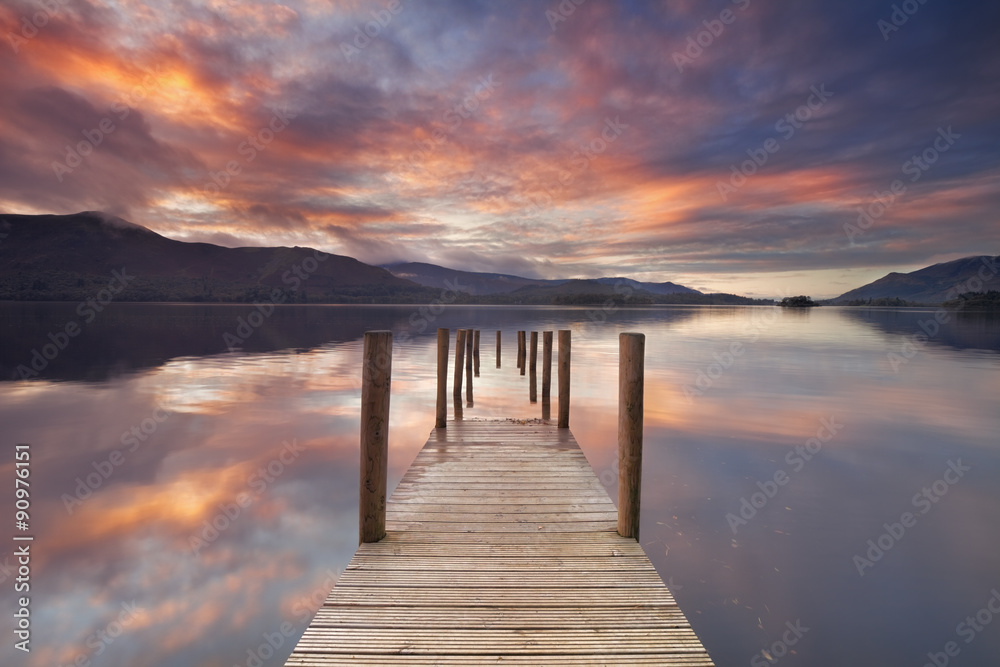Fototapeta Flooded jetty in Derwent Water, Lake District, England at sunset