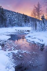 Fototapeta Zima Sunrise over a river in winter near Levi, Finnish Lapland