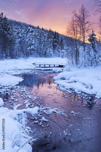 Sunrise over a river in winter near Levi, Finnish Lapland - 90977338