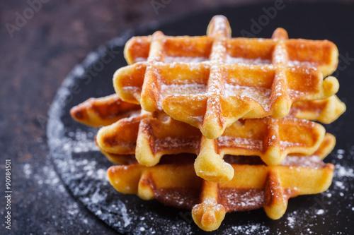 Fotografía  Belgian waffles  on a black background.