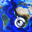 canvas print picture - stethoscope on a world map (furnished by NASA)