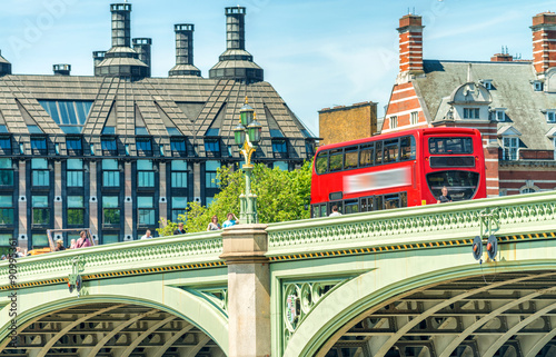 Poster Londres bus rouge London. Classic Red Double Decker Bus speeding up in city street
