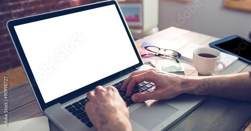 Obraz Cropped hand of graphic designer using laptop - fototapety do salonu