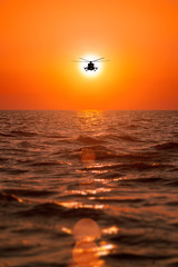 FototapetaMi-8 helicopters, warm sunset