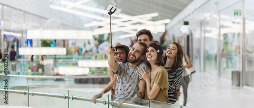 Fotografía  Hipsters In Shopping Mall Taking Selfie