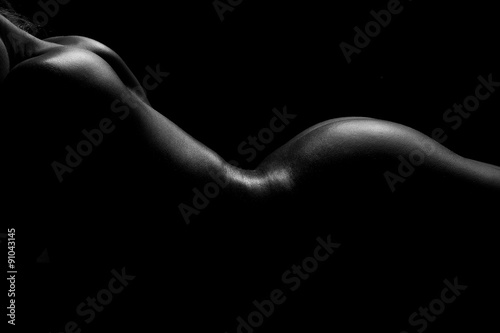 silhouette of a naked female back and buttocks