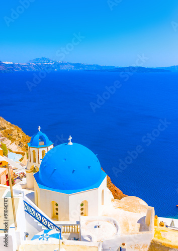 Foto op Aluminium Santorini The blue colored dome of an old traditional church in Oia the most beautiful village of Santorini island in Greece