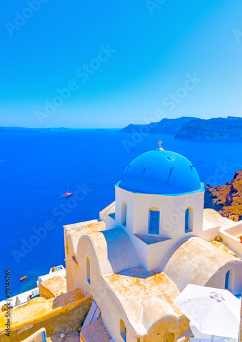 Foto op Aluminium Santorini Traditional old church with blue colored dome in Oia the most beautiful village of Santorini island in Greece