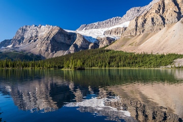 Crowfoot Glacier reflects on Bow Lake in Banff National Park