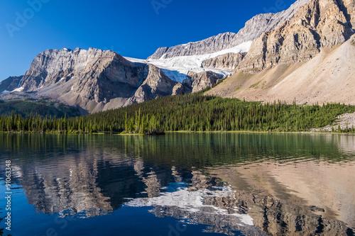 Fotografie, Obraz  Crowfoot Glacier reflects on Bow Lake in Banff National Park
