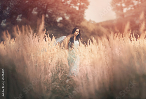 Beautiful, romantic woman in fairytale, wood nymph among tall Poster