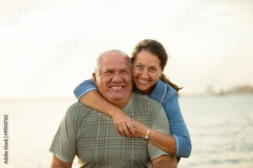Fototapety, obrazy:  mature couple   during sunset.