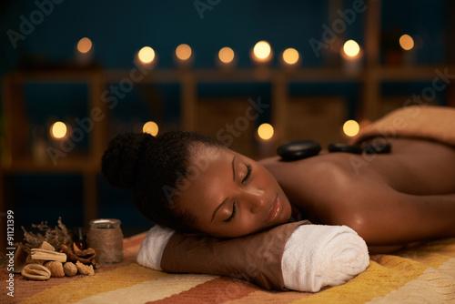 Photo  Enjoying stone massage