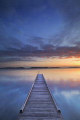 Naklejka Molo Jetty on a lake at sunrise, near Amsterdam The Netherlands