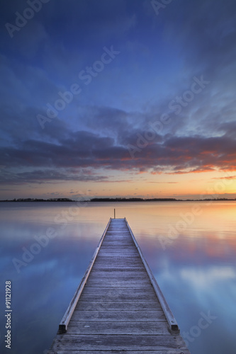 Jetty on a lake at sunrise, near Amsterdam The Netherlands - 91121928