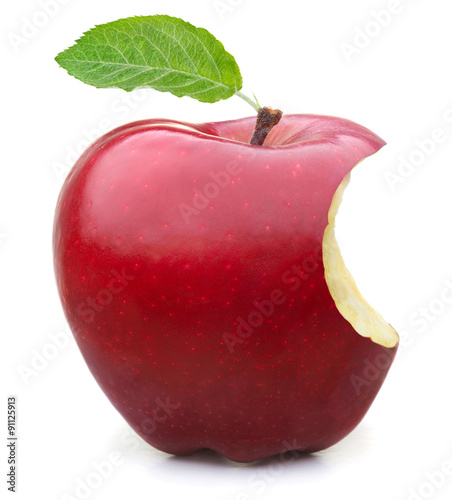 Cuadros en Lienzo  Red apple with missing a bite isolated on white background