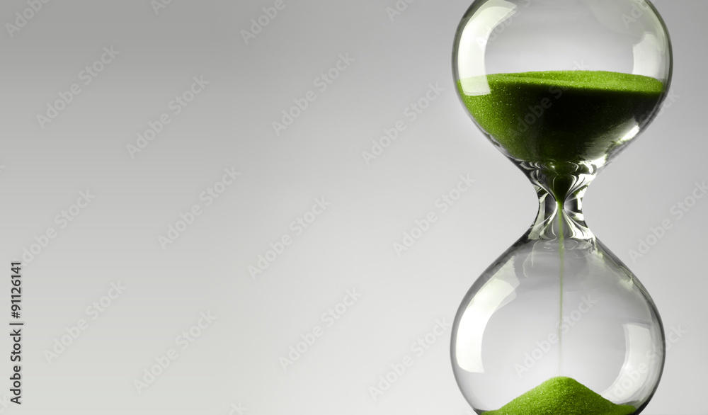 Time passing. Green hourglass.