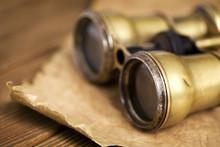 Antique Binoculars On Vintage Paper Background