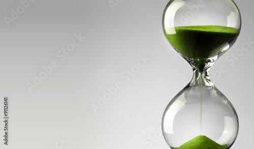 Time passing. Green hourglass. Fototapete