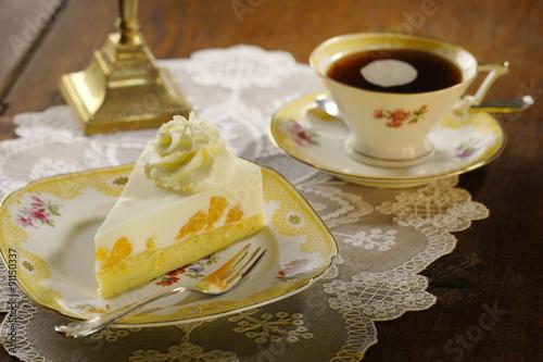 Photo cake with cream and tangerines