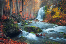 Beautiful Waterfall In Autumn Forest In Crimean Mountains At Sun