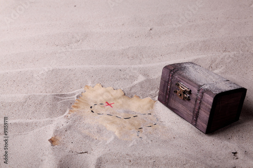 Fotografie, Obraz  An old chest and a treasure map found in the sand