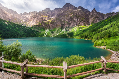 Fototapeta Crystal clear pond in the middle of the mountains obraz