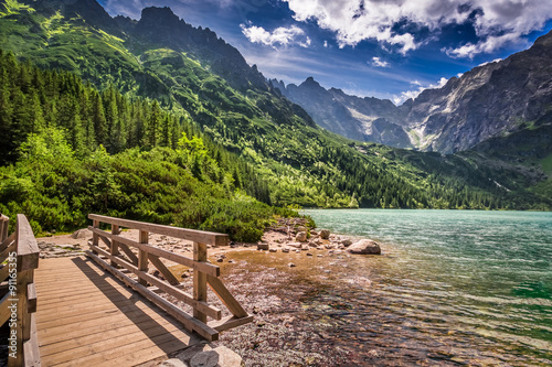 Tuinposter Diepbruine Beautiful lake in the mountains at summer