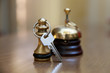 A service bell and room key in the hotel