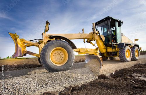Obraz na plátně Grader working on gravel leveling
