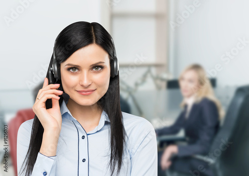 Fotografie, Obraz Front view of the smiling brunette support phone operator with headset