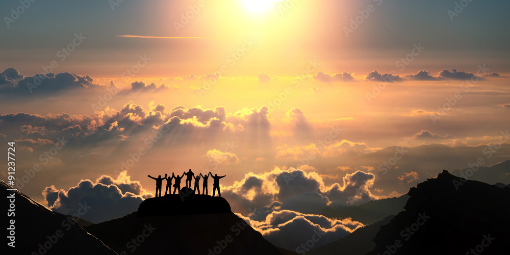 Fototapety, obrazy: On the top of the world together. A group of people stands on a hill over the beautiful cloudscape.
