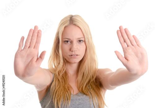 Fototapeta  Junge Frau zeigt Stopp mit zwei Händen