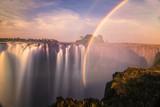 Fototapeta Tęcza - A sunset at the Victoria Falls