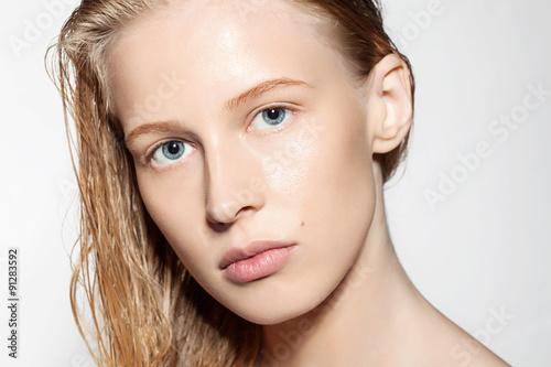 fototapeta na lodówkę Woman with blonde hair wet without makeup
