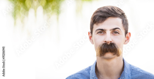 Obraz Young man with fake mustaches. Dental health concept. - fototapety do salonu