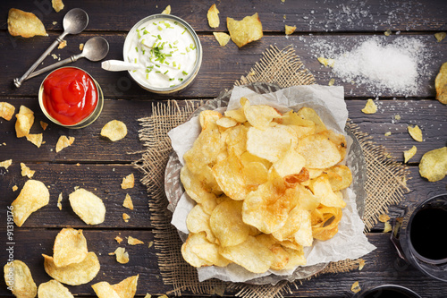 Fotografie, Obraz  Potato chips with dipping sauces on a rustic table