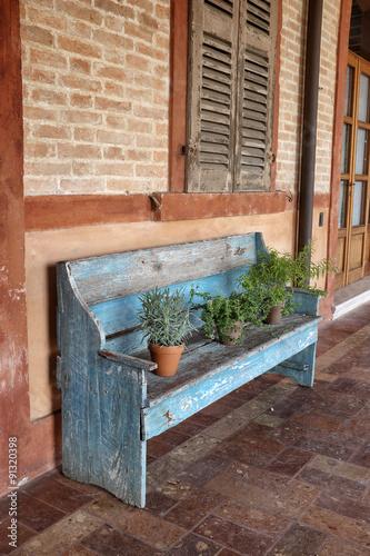 Foto op Canvas Tuin Ambiente con panchina in legno