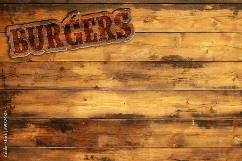 Spoed Foto op Canvas Grill / Barbecue burger sign nailed to a wooden wall