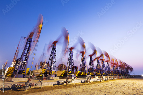 Fototapeta oil pumps working at oilfiled obraz