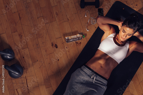Fitness woman doing abs workout at the gym Poster